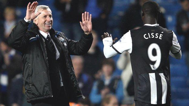 Newcastle manager Alan Pardew (left) celebrates with Senegal's Papiss Demba Cisse