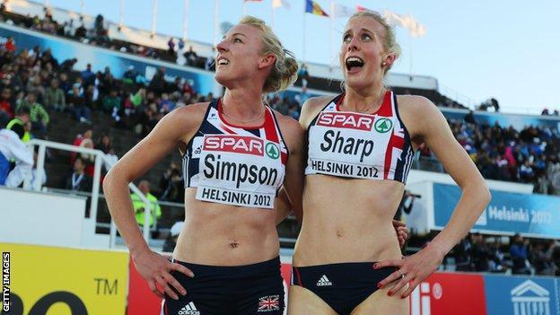 Sharp (right) celebrates her European silver medal