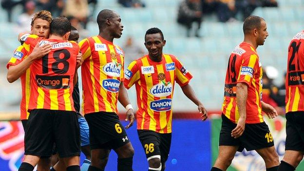 Esperance players congratulate Youssef Msakni (L) on scoring against Brikama United during their African Champions League match in April