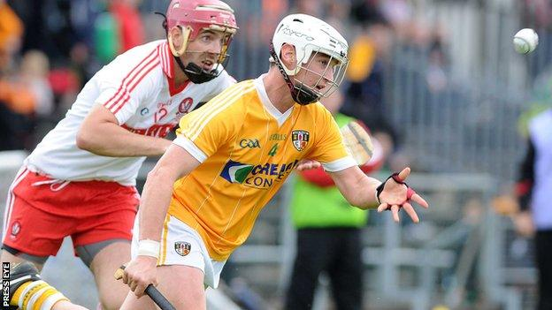 Antrim's Aaron Graffin battles with Derry's Kevin Hinphey at Casement Park