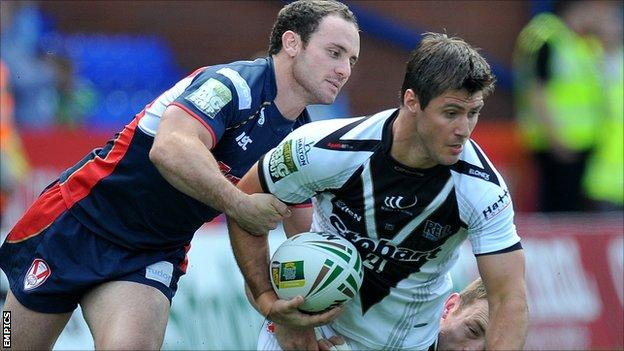 Widnes' Dave Allen is tackled by Lance Hohaia of St Helens during Sunday's Super League match at the Stobart Stadium