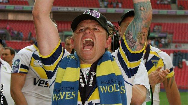 Lee Briers celebrates one of his two Challenge Cup victories with Warrington Wolves