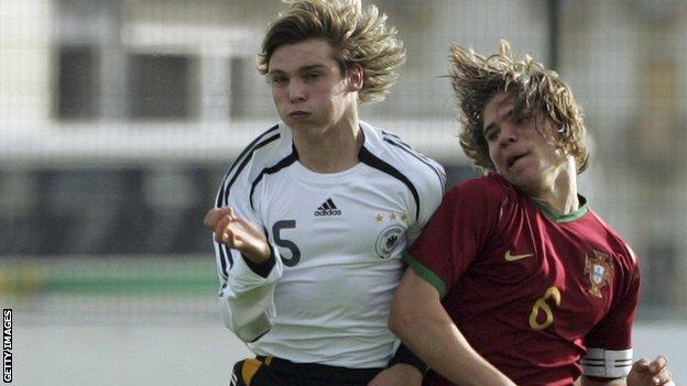 Portuguese midfielder Diogo Amado (right)