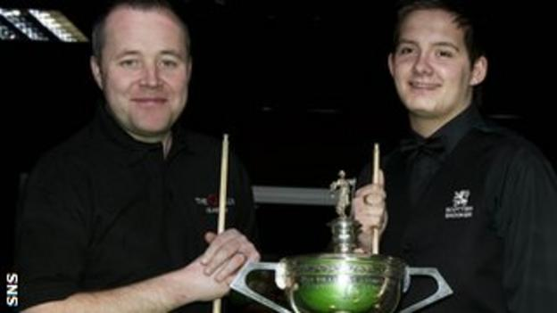 Michael Leslie poses with four-times World champion John Higgins