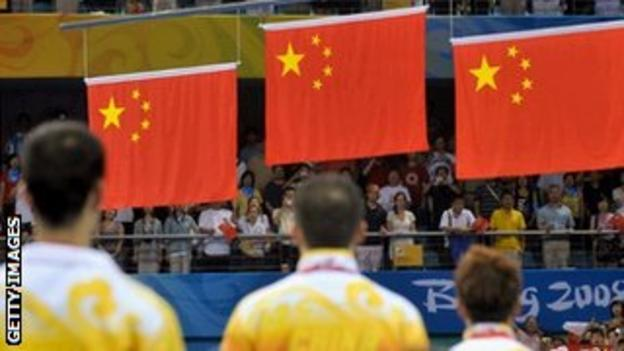 Chinese athletes celebrate a one-two-three in table tennis