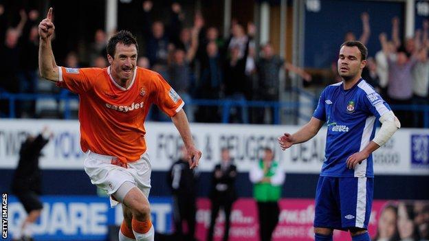 Zdenek Kroca of Luton Town celebrates a goal