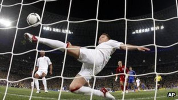 John Terry clears a ball off the line during England's 1-0 win over Ukraine at Euro 2012
