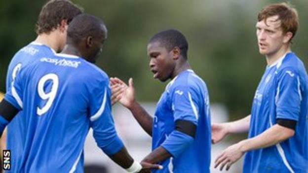 Tade congratulates scorer Hasselbaink during the pre-season win over East Fife