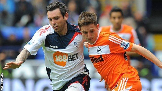 Mark Davies takes on Joe Allen in April 2012