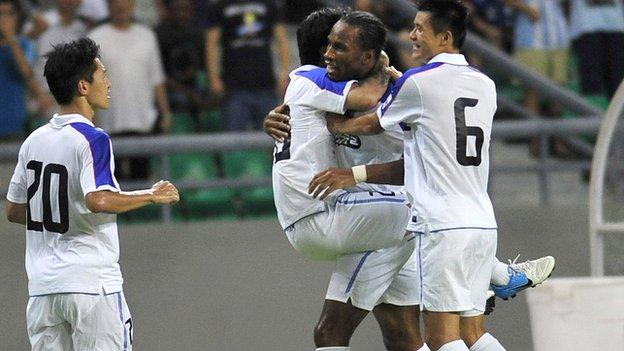 Didier Drogba is congratulated after setting up a goal on his Chinese League debut