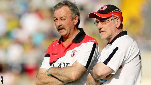 Mickey Harte [right] and his assistant Tony Donnelly watch the game in Killarney