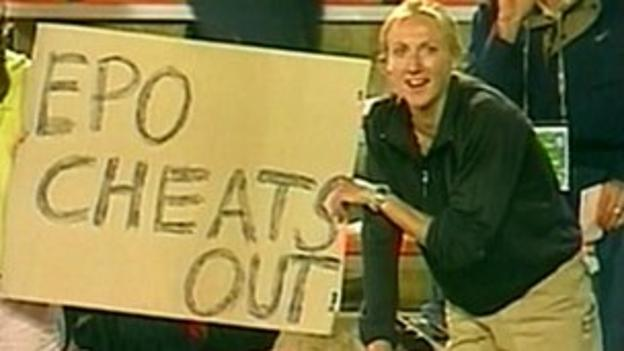"""(File photo 2001) Paula Radcliffe holds a sign saying """"EPO Cheats Out"""""""