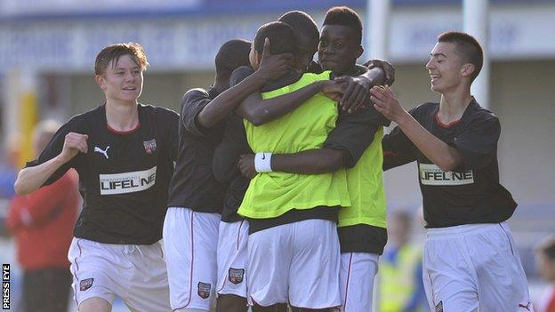 Brentford players celebrate Herson Rodrigues Alves' goal in the win over Liverpool