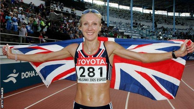 Paula Radcliffe celebrates victory in the marathon at the 2005 World Championships