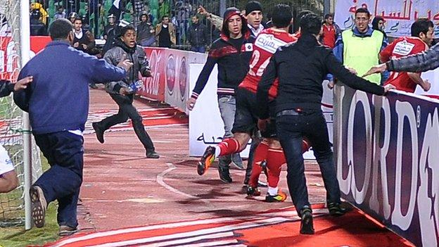 Al Ahly players leave the pitch at Port Said