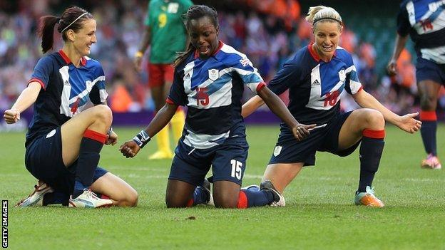 Jill Scott celebrates her goal against Cameroon