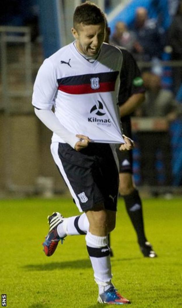 Conroy celebrates after scoring the winning penalty at Balmoor Stadium