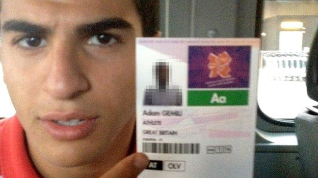 Adam Gemili holds up his Olympic accreditation