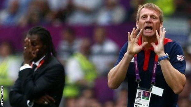 Britain's coach Stuart Pearce (right) shouts instructions