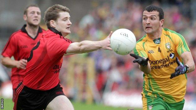 Down's Conor Maginn and Donegal's Frank McGlynn battle for possession in last month's Ulster Final