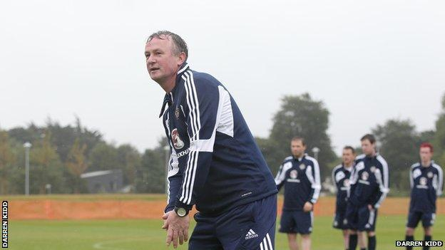 NI manager Michael O'Neill puts the assembled journalists through their paces