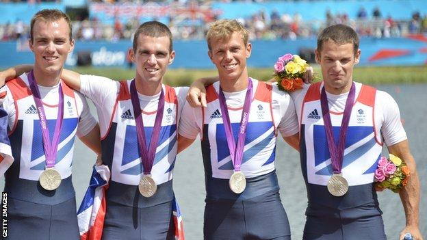 Great Britain's Peter Chambers, Rob Williams, Richard Chambers and Chris Bartley pose on the podium after receiving their silver medals in the men's lightweight four final