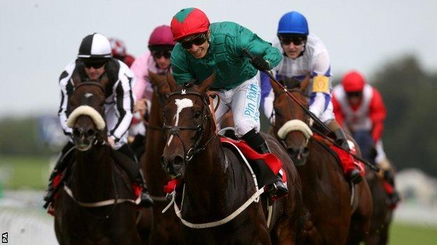 Fulbright and jockey Silvestre de Sousa (green silks with green and red hat)