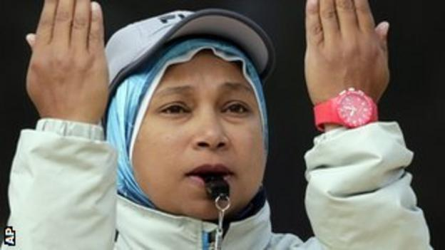 Amina El Sergany officiates during a beach volleyball match at the Olympics