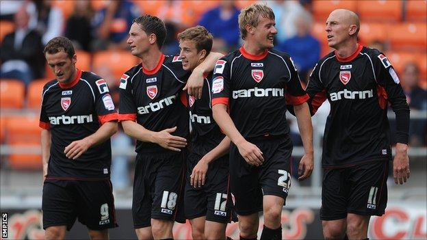Morecambe players celebrate Andrew Fleming's goal against Blackpool