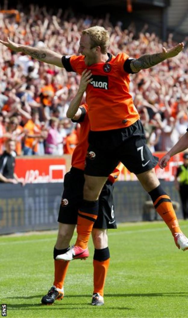 Russell celebrates as he scores against Dundee before being sent off