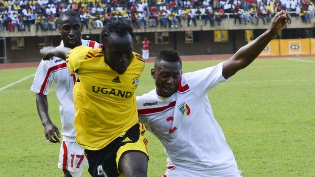 Brian Umony (centre) is out of Uganda's match against Zambia