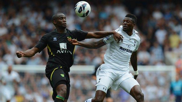 Norwich defender Sebastien Bassong and Emmanuel Adebayor of Spurs