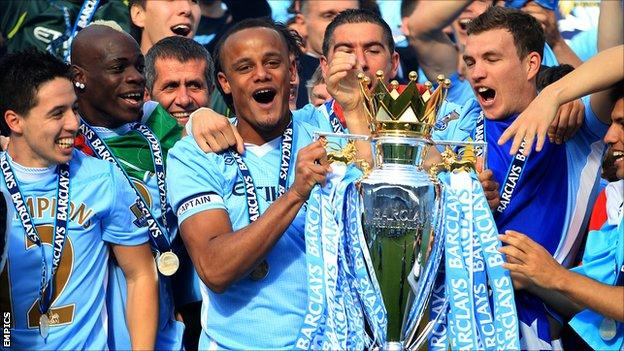 Manchester City captain Vincent Kompany lifts the Premier League trophy in May