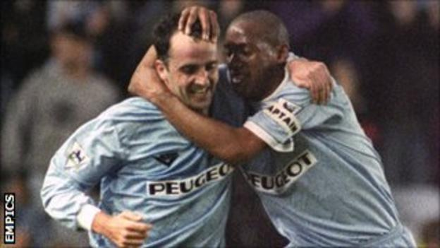 Accrington Stanley manager Paul Cook (l) celebrates with Dion Dublin after scoring a goal for Coventry City