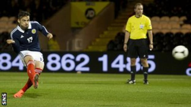 Tony Watt scores a penalty for Scotland Under-21s against Luxembourg