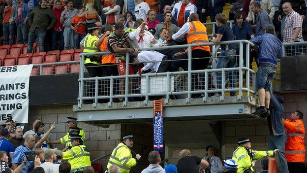 Police and stewards intervene as fans battle at Tannadice