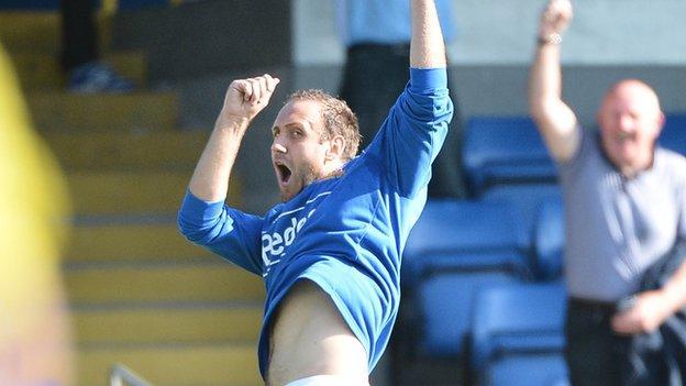 Guy Bates celebrates after his goal against Crusaders