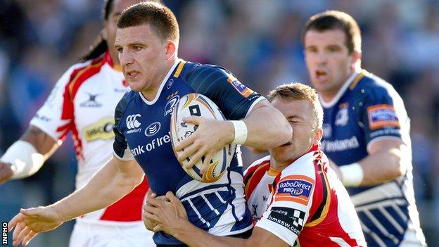 The Dragons' Tom Prydie attempts to halt Leinster's Andrew Conway