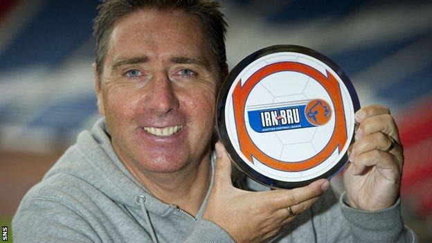 Peterhead manager Jim McInally with his Irn Bru award