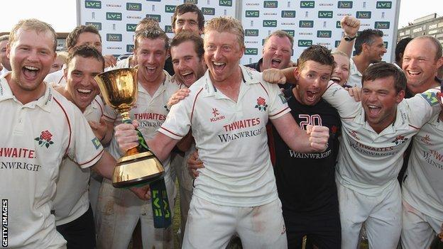 Lancashire with the County Championship cup in 2011