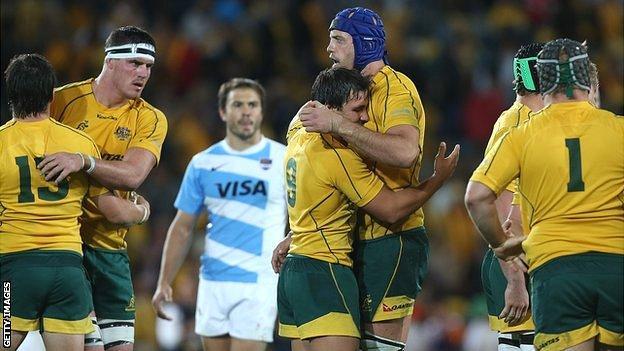 Australia's Nathan Sharpe and Nick Phipps celebrate