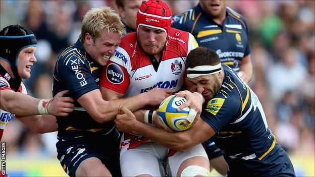 Gloucester's Ben Morgan is tackled by Worcester duo Joe Carlisle and Sam Betty