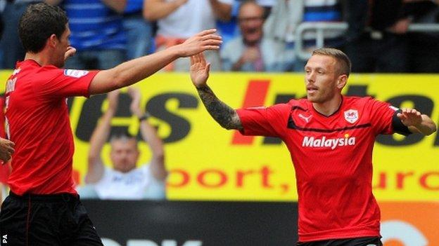 Craig Bellamy celebrates after scoring against Leeds United