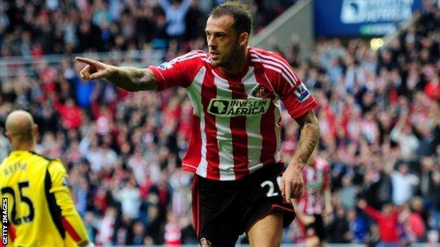 Fletcher celebrates after scoring against Liverpool at the Stadium of Light