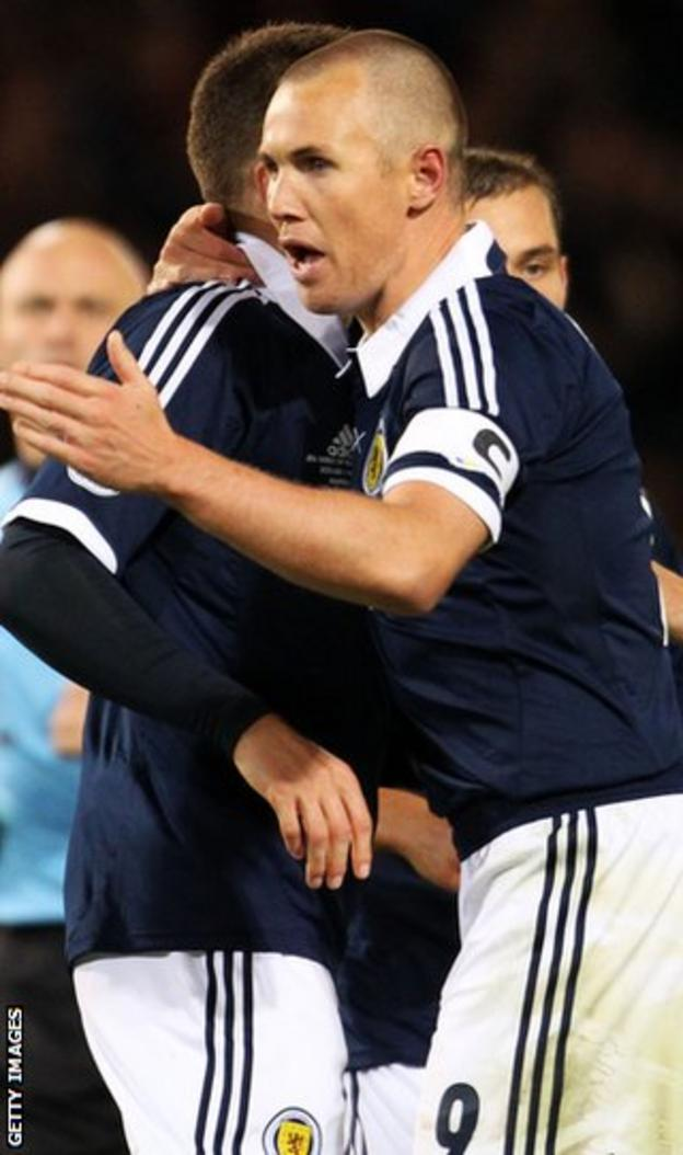 Miller celebrates after scoring for Scotland against Macedonia