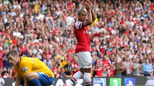 Theo Walcott celebrates scoring against former club Southampton