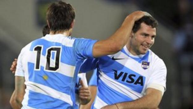 Tomas Leonardi celebrates scoring a try for Argentina