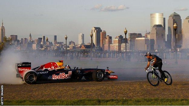 Former Red Bull Racing Formula 1 driver David Coulthard drives the Red Bull running show car through Liberty State Park in New Jersey