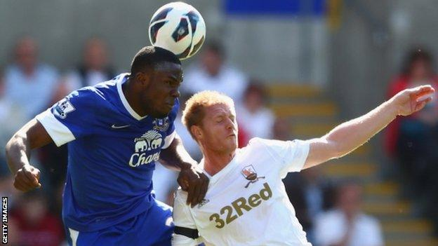 Alan Tate is beaten in the air by Everton's Victor Anichebe