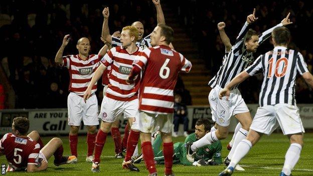 St Mirren celebrate after their winner through Lee Mair (second right)